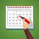 naptár és egy kéz a marketing tervezés fontosságának illusztrálására